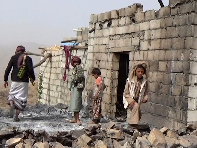Yemenis at the site of the January 29 US military attack