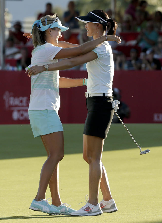 Lexi Thompson, left, hugs Michelle Wie after Thompson's three-stroke victory over Wie in the Kraft Nabisco Championship golf tournament Sunday, April 6, 2014, in Rancho Mirage, Calif. (AP Photo/Chris Carlson)