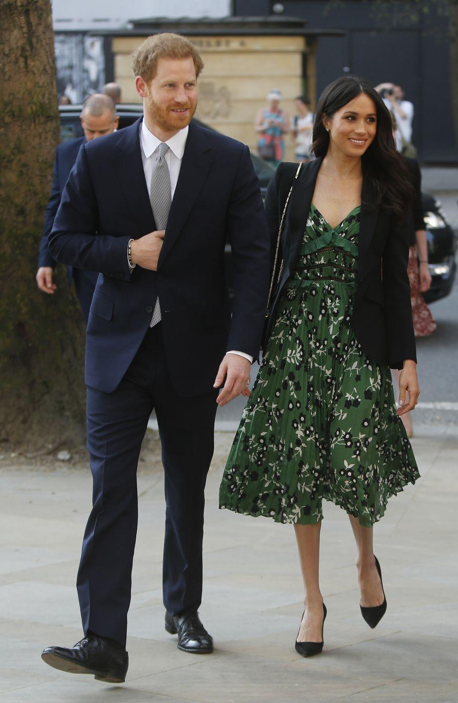 """<p>Meghan opted for a <a href=""""https://www.harrods.com/en-gb/self-portrait/cold-shoulder-floral-dress-p000000000005821467"""" rel=""""nofollow noopener"""" target=""""_blank"""" data-ylk=""""slk:vibrant green dress from Self Portrait"""" class=""""link rapid-noclick-resp"""">vibrant green dress from Self Portrait</a> paired with a dark blazer and black pointy-toe pumps for an <a href=""""https://www.townandcountrymag.com/society/tradition/a12044088/what-are-the-invictus-games-competition/"""" rel=""""nofollow noopener"""" target=""""_blank"""" data-ylk=""""slk:Invictus Games event in London"""" class=""""link rapid-noclick-resp"""">Invictus Games event in London</a>.</p><p><a class=""""link rapid-noclick-resp"""" href=""""https://go.redirectingat.com?id=74968X1596630&url=https%3A%2F%2Fwww.neimanmarcus.com%2FSelf-Portrait-Cold-Shoulder-Floral-Print-Midi-Dress-with-Pleats-Frills%2Fprod206200208%2Fp.prod&sref=https%3A%2F%2Fwww.townandcountrymag.com%2Fstyle%2Ffashion-trends%2Fg3272%2Fmeghan-markle-preppy-style%2F"""" rel=""""nofollow noopener"""" target=""""_blank"""" data-ylk=""""slk:SHOP NOW"""">SHOP NOW</a> <em>Self-Portrait Cold-Shoulder Floral-Print Midi Dress, $510</em><br></p>"""
