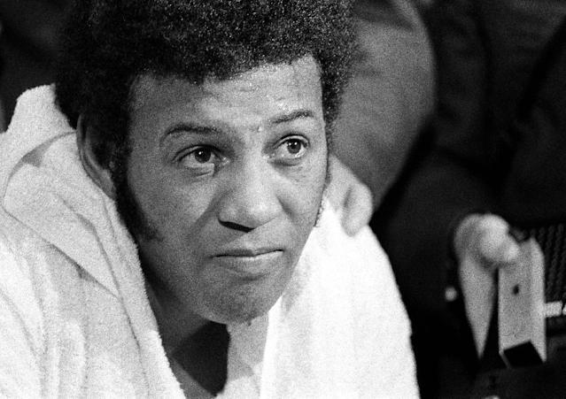 FILE - In this Feb. 16, 1970, file photo, a defeated Jimmy Ellis as shown in his dressing room after losing heavyweight title bout to Joe Frazier at New York's Madison Square Garden. Ellis, a former heavyweight boxing champion who trained with fellow Louisville fighter Muhammad Ali and squared off against some of his era's best fighters, has died in his hometown Tuesday, May 6, 2014. He was 74. Ellis' brother, Jerry, said the ex-champion died at a Louisville hospital Tuesday after suffering from Alzheimer's disease in recent years. (AP Photo/File)