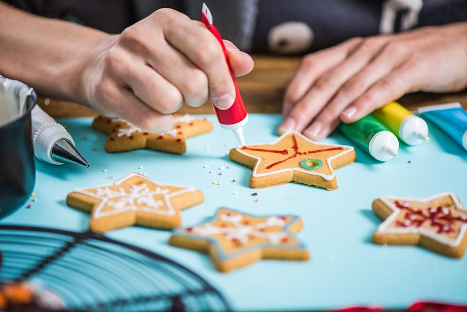 "<p>Turn one of your holiday baking chores into a game for the whole family by turning up the heat with a little friendly competition. Whoever makes the best cookie wins. Add categories for messiest, zaniest or most sprinkles for bigger crowds. Bonus: everyone gets to eat their creations at the end. </p><p><strong>RELATED:</strong> <a href=""https://www.goodhousekeeping.com/food-recipes/dessert/g4057/decorating-christmas-cookies/"" rel=""nofollow noopener"" target=""_blank"" data-ylk=""slk:40 Creative and Easy Ideas for Decorating Christmas Cookies"" class=""link rapid-noclick-resp"">40 Creative and Easy Ideas for Decorating Christmas Cookies</a></p>"