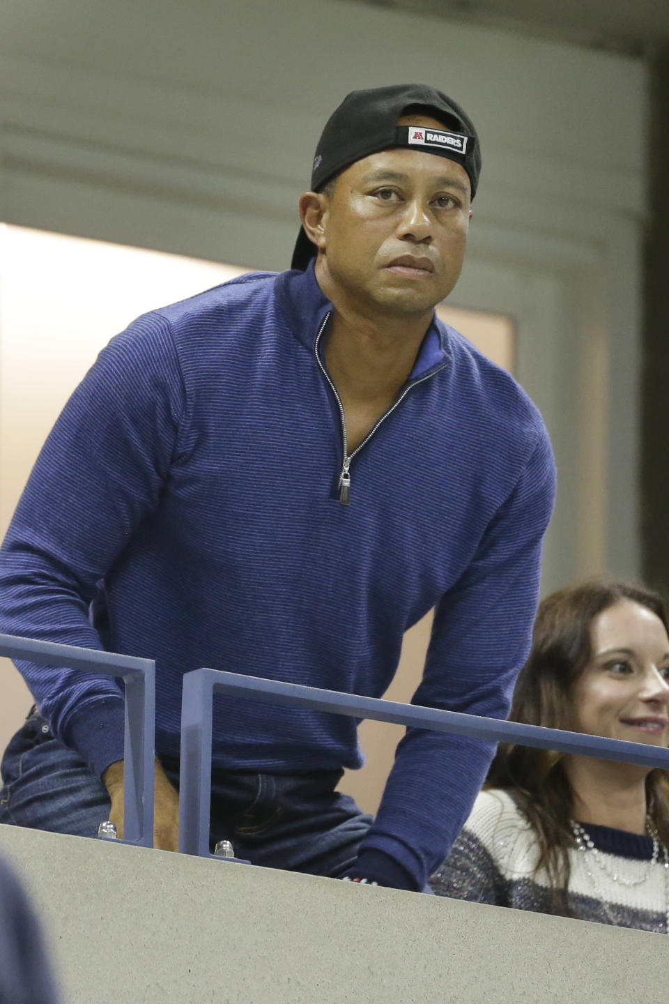Golfer Tiger Woods watches a match between Rafael Nadal, of Spain, and Marin Cilic, of Croatia, during the fourth round of the U.S. Open tennis tournament, Monday, Sept. 2, 2019, in New York. (AP Photo/Seth Wenig)