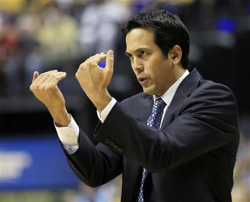 Miami Heat head coach Erik Spoelstra gestures to his team during the first half of Game 4 of their NBA basketball Eastern Conference semifinal playoff series against the Indiana Pacers, Sunday, May 20, 2012, in Indianapolis. (AP Photo/Darron Cummings)