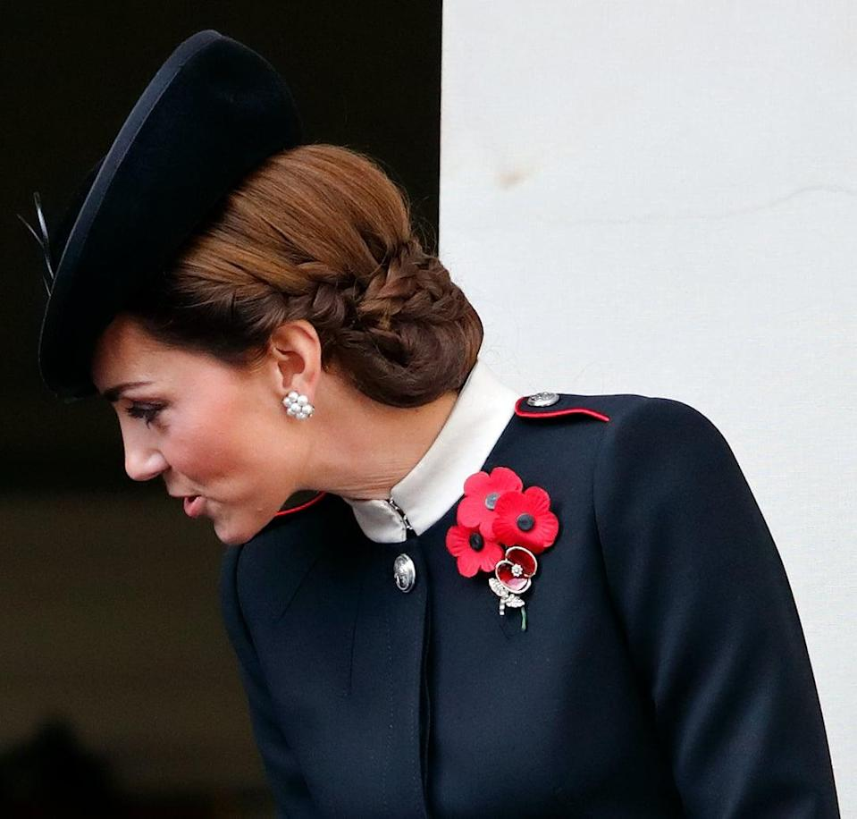 <p>The duchess took her go-to hair silhouette and spiced things up, adding thick French braids that started right above her ears and reached across the back of her head, holding the ends of her hair - which seem to be looped under towards her neck - neatly in place. </p>