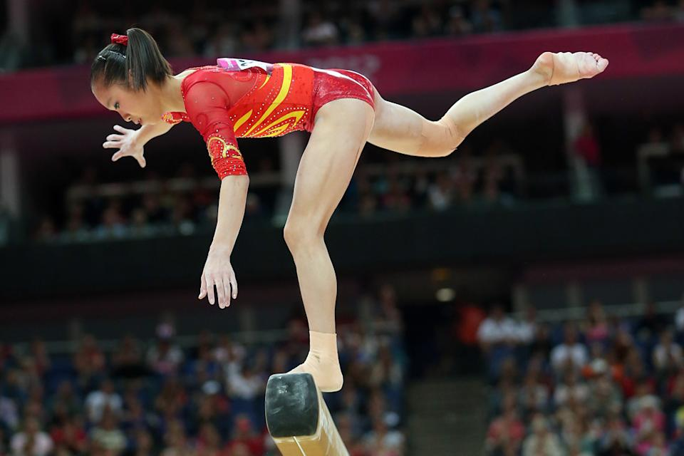 Jinnan Yao of China attempts to stay on the beam in the Artistic Gymnastics Women's Team qualification on Day 2 of the London 2012 Olympic Games at North Greenwich Arena on July 29, 2012 in London, England. (Photo by Ronald Martinez/Getty Images)