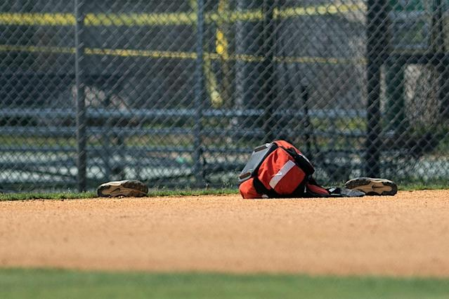 <p>A view of shoes left at a baseball field after a shooting during a practice of the Republican congressional baseball at Eugene Simpson Statium Park June 14, 2017 in Alexandria, Va. (Photo: Brendan Smialowski/AFP/Getty Images) </p>