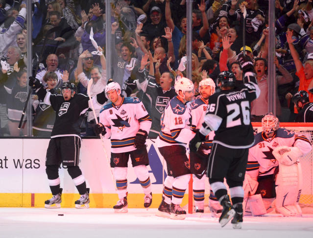 Members of the Los Angeles Kings celebrate center Trevor Lewis's game winning goal against the San Jose Sharks during the third period in Game 2 of their second-round NHL hockey Stanley Cup playoff series, Thursday, May 16, 2013, in Los Angeles. (AP Photo/Mark J. Terrill)