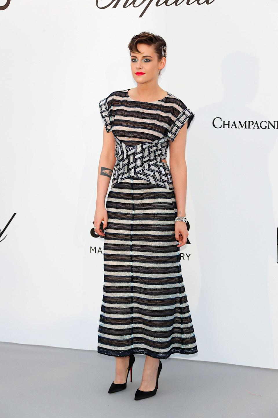 <p>Kristen Stewart saved her best look until last, as she donned monochrome Chanel stripes at the amfAR Gala during Cannes Film Festival. <em>[Photo: Getty]</em> </p>
