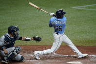 Tampa Bay Rays' Randy Arozarena connects for a three-run home run off New York Yankees pitcher Michael King during the sixth inning of a baseball game Thursday, May 13, 2021, in St. Petersburg, Fla. Catching for the Yankees is Gary Sanchez. (AP Photo/Chris O'Meara)