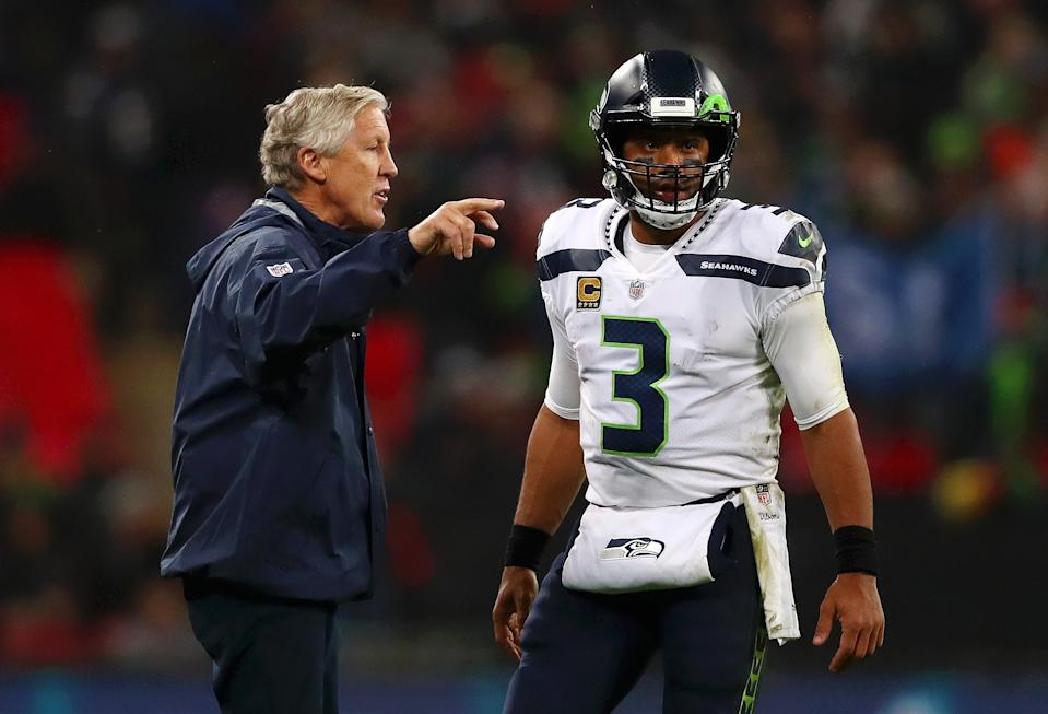 LONDON, ENGLAND - OCTOBER 14:  Seattle Seahawks Head Coach, Pete Carroll speaks to Russell Wilson of Seattle Seahawks during the NFL International series match between Seattle Seahawks and Oakland Raiders at Wembley Stadium on October 14, 2018 in London, England.  (Photo by Naomi Baker/Getty Images)