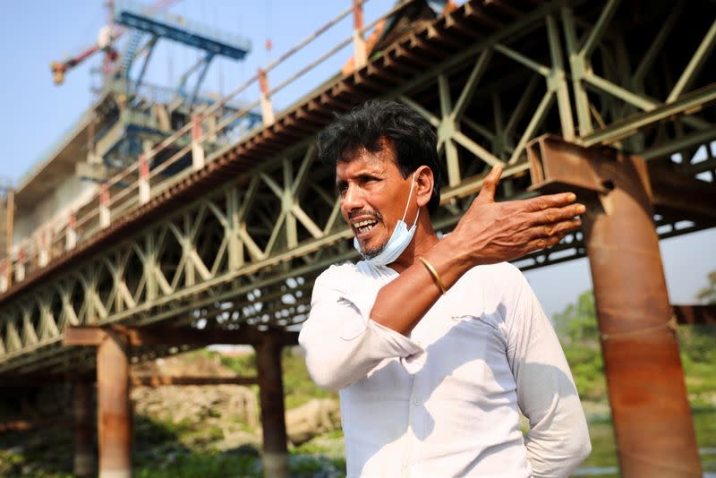A relative of victims reacts after several people died as a ferry collided with a cargo vessel and sank on Sunday in the Shitalakhsyaa River in Narayanganj