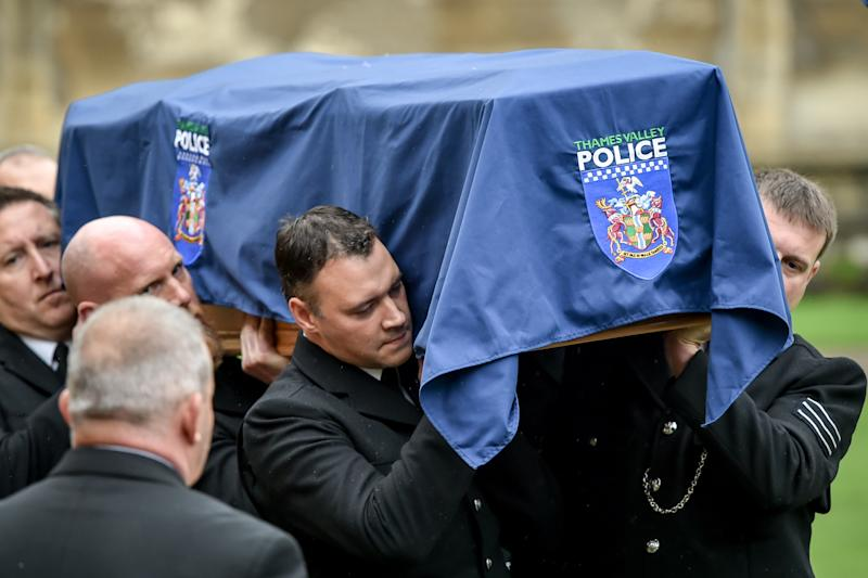 Pallbearers carry the coffin of PC Andrew Harper, the Thames Valley Police officer who died from multiple injuries after being dragged under a van while responding to reports of a burglary, arrives in the quadrangle at Christ Church Cathedral in St Aldate's, Oxford.
