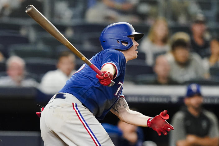Texas Rangers' Brock Holt follows through on an RBI single during the fourth inning of a baseball game against the New York Yankees Wednesday, Sept. 22, 2021, in New York. (AP Photo/Frank Franklin II)
