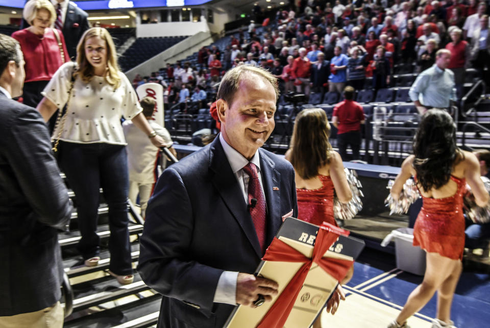 Kermit Davis Jr., center, leaves the stage after being introduced as Mississippi's new men's basketball coach in Oxford, Miss., Monday, March 19, 2018. (Bruce Newman, Oxford Eagle via AP)
