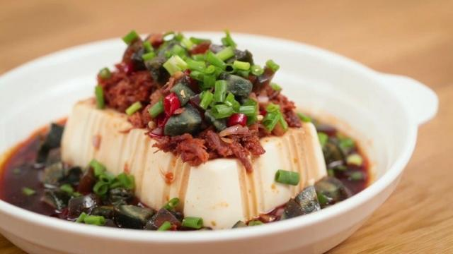 Century egg tofu with spicy canned pork cubes dishes