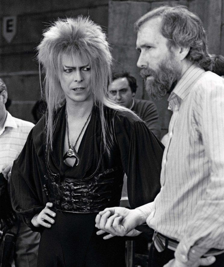 Bowie and Henson consult on the set of <em>Labyrinth</em> in this rare image. (Photo provided by Insight Editions from <em>Labyrinth: The Ultimate Visual History.</em> ©2016 The Jim Henson Co. All rights reserved.)