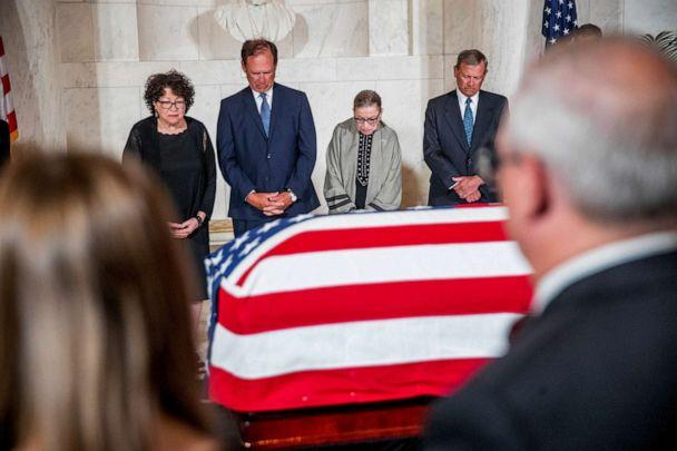 PHOTO: A moment of silence during a private ceremony in the Great Hall of the Supreme Court in Washington, July 22, 2019, where the late Supreme Court Justice John Paul Stevens lies in repose. (Andrew Harnik/AP)