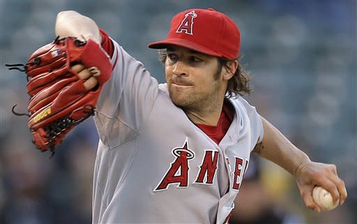 Los Angeles Angels' C.J. Wilson works against the Oakland Athletics during the first inning of a baseball game, Tuesday, May 22, 2012, in Oakland, Calif. (AP Photo/Ben Margot)