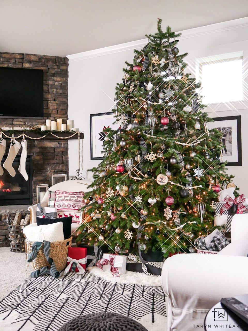 """<p>Lean into a subtle Scandinavian theme with nature-inspired accents, sleek metal touches, and adorable woodland creature ornaments. </p><p><strong><em>Get the tutorial at <a href=""""https://tarynwhiteaker.com/woodland-chic-christmas-tree-9/"""" rel=""""nofollow noopener"""" target=""""_blank"""" data-ylk=""""slk:Taryn Whitaker Designs"""" class=""""link rapid-noclick-resp"""">Taryn Whitaker Designs</a>. </em></strong></p><p><a class=""""link rapid-noclick-resp"""" href=""""https://www.amazon.com/Snowflakes-Christmas-Ornaments-Hanging-Decorations/dp/B08HJ6JSPW?tag=syn-yahoo-20&ascsubtag=%5Bartid%7C10070.g.2025%5Bsrc%7Cyahoo-us"""" rel=""""nofollow noopener"""" target=""""_blank"""" data-ylk=""""slk:SHOP WOOD SNOWFLAKE ORNAMENTS"""">SHOP WOOD SNOWFLAKE ORNAMENTS</a></p>"""
