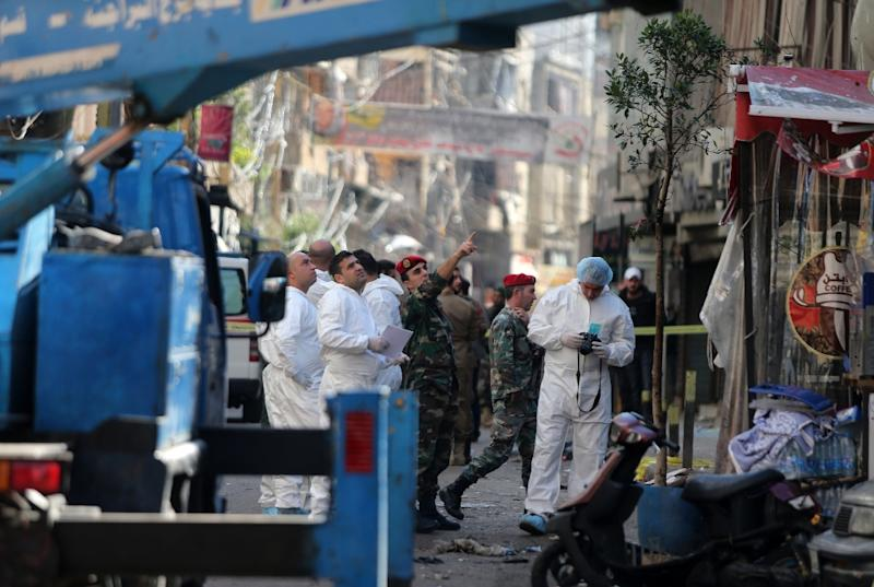 Lebanese forensic police and security forces inspect the site of a twin bomb attack that rocked a busy shopping street in a Beirut stronghold of Lebanon's Shiite movement Hezbollah, the day after the attack on November 13, 2015 (AFP Photo/)