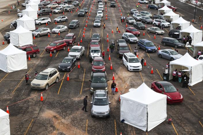 Cars lined up at an outdoor vaccination site.