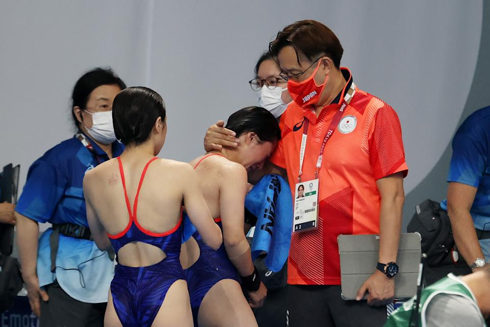 TOKYO, JAPAN - JULY 27: Minami Itahashi and Matsuri Arai of Team Japan react after their final dive during the Women's Synchronised 10m Platform Final on day four of the Tokyo 2020 Olympic Games at Tokyo Aquatics Centre on July 27, 2021 in Tokyo, Japan. (Photo by Al Bello/Getty Images)