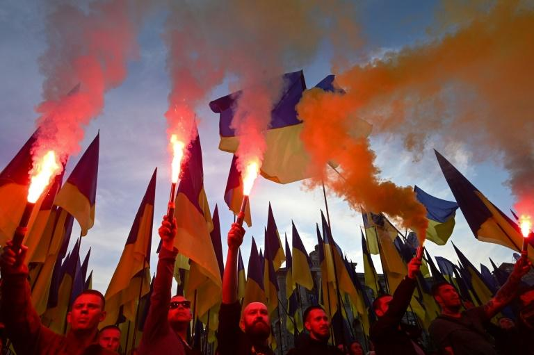 Thousands of protesters, many veterans of the conflict in eastern Ukraine, paraded through the capital with flares burning, singing the national anthem and chanting slogans against President Volodymyr Zelensky (AFP Photo/GENYA SAVILOV)