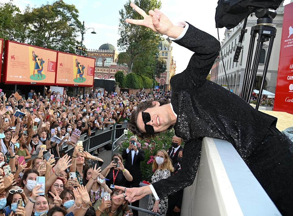 <p>Timothée Chalamet poses with fans as he attends the red carpet of the movie <em>Dune</em> during the 78th Venice International Film Festival on Sept. 3 in Italy. </p>