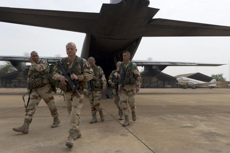 """In this picture dated Sunday, Jan. 13, 2013 and released by the French Army Communications Audiovisual office (ECPAD) shows French legionnaires of the 1st Foreign Cavalry Regiment based in Orange, southern France, exiting a military plane at Bamako airport, Mali. An official at France's Defense Ministry says the country will """"gradually deploy"""" a total of 2,500 troops to Mali, and the French president says the military operation will last until security has been restored and African forces are ready to take charge. (AP Photo/Jeremy Lempin, ECPAD)"""
