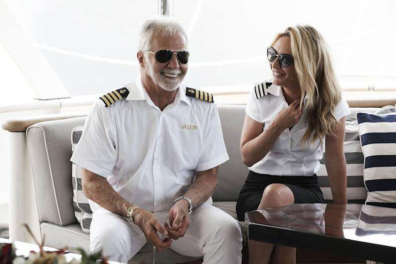 Kate Chastain and a Captain from Below Deck, are having a conversation on the boat, and they look excited