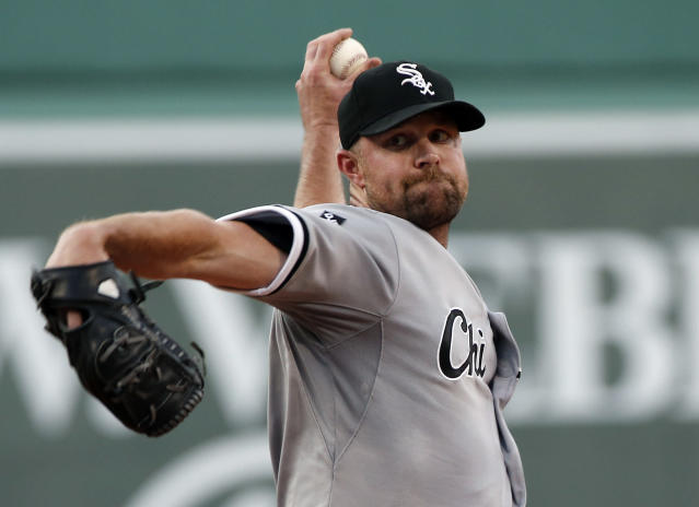 Chicago White Sox starting pitcher John Danks delivers to the Boston Red Sox in the first inning of a baseball game at Fenway Park in Boston, Tuesday, July 8, 2014. (AP Photo/Elise Amendola)