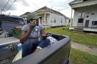 Linda Smoot, who evacuated from Hurricane Laura in a pickup truck with eight others, reacts as they return to see the damaged home of her niece for the first time, in Lake Charles, La., in the aftermath of the hurricane, Sunday, Aug. 30, 2020. (AP Photo/Gerald Herbert)