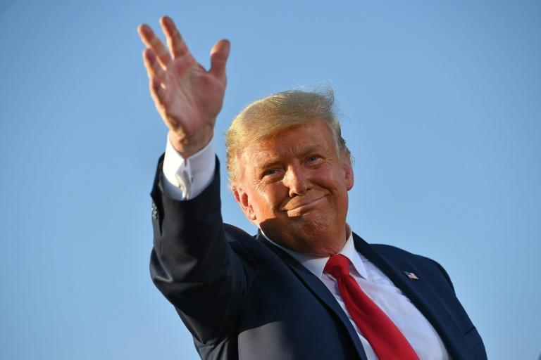 US President Donald Trump, who has refused to concede defeat, waves during an October 2020 election rally in Tucson, Arizona
