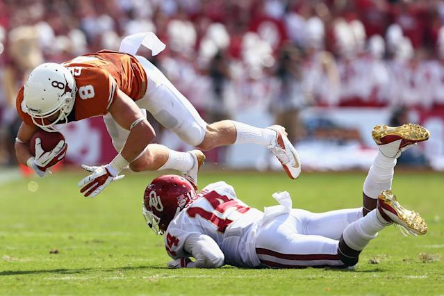 DALLAS, TX - OCTOBER 12: Jaxon Shipley #8 of the Texas Longhorns carries the ball against Aaron Colvin #14 of the Oklahoma Sooners in the second quarter at the Cotton Bowl on October 12, 2013 in Dallas, Texas. (Photo by Tom Pennington/Getty Images)