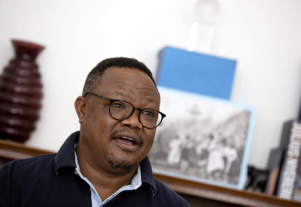 """Exiled Tanzanian opposition leader Tundu Lissu gives an interview to The Associated Press in Tienen, Belgium on Friday, March 19, 2021. Speaking of Tanzania's new president Samia Suluhu Hassan, who was sworn-in on Friday, Lissu said """"The immediate job, the immediate decision she has to make, and she doesn't have much time for it, is what is she going to do about COVID-19? President Magufuli defied the world, defied science, defied common sense in his approach to COVID-19 and it finally brought him down."""" (AP Photo/Virginia Mayo)"""