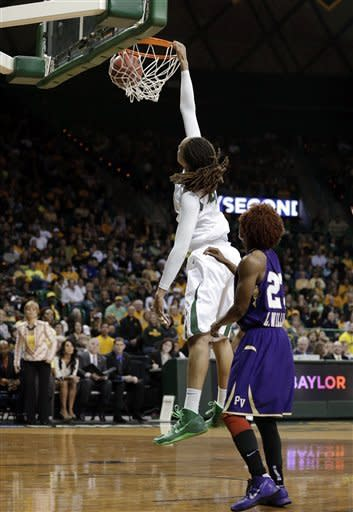 Baylor's Brittney Griner (42) dunks as Prairie View A&M's Latia Williams (23) watches in the second half of a first-round game in the women's NCAA college basketball tournament, Sunday, March 24, 2013, in Waco, Texas. Griner had 33-points in the 82-40 Baylor win. (AP Photo/Tony Gutierrez)