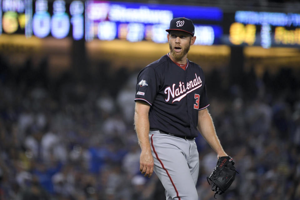 Washington Nationals starting pitcher Stephen Strasburg yells during the sixth inning in Game 2 of the baseball team's National League Division Series against the Los Angeles Dodgers on Friday, Oct. 4, 2019, in Los Angeles. (AP Photo/Mark J. Terrill)