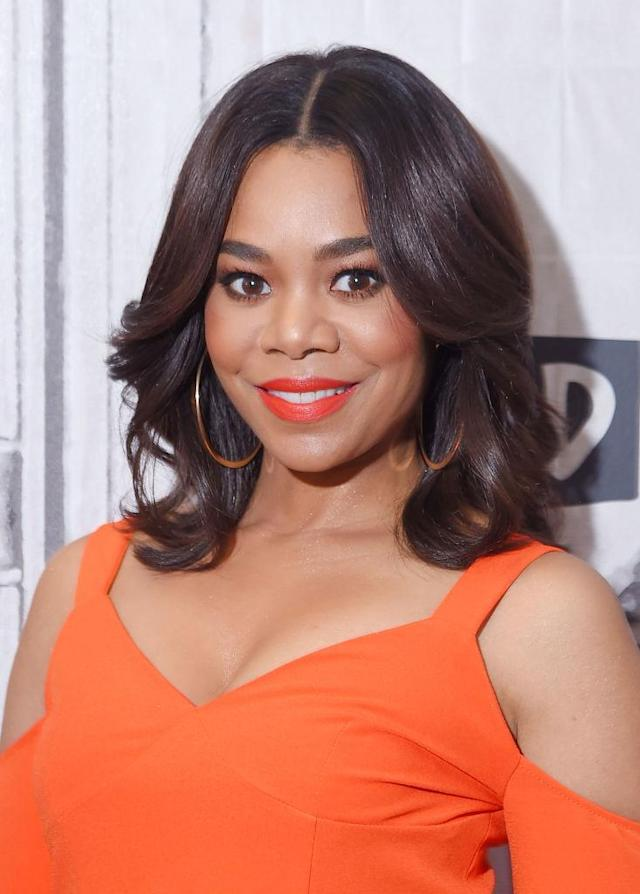 <p>Hall made a visit to AOL's Build Series to discuss her new movie, <em>Girls Trip</em>, and we just can't get over her bright summer makeup. She matched her coral lipstick to her outfit perfectly and kept her hair sleek in layered, glossy waves. (Photo: Michael Loccisano/Getty Images) </p>