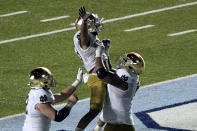 Notre Dame running back Kyren Williams is hoisted by offensive lineman Aaron Banks (69) following Williams' touchdown against North Carolina during the second half of an NCAA college football game in Chapel Hill, N.C., Friday, Nov. 27, 2020. (AP Photo/Gerry Broome)