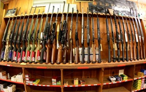 Various rifles are on display at Clark Brothers gun store in Virginia, where new laws under consideration would prohibit magazines with more than 10 rounds and the purchase of more than one weapon per month