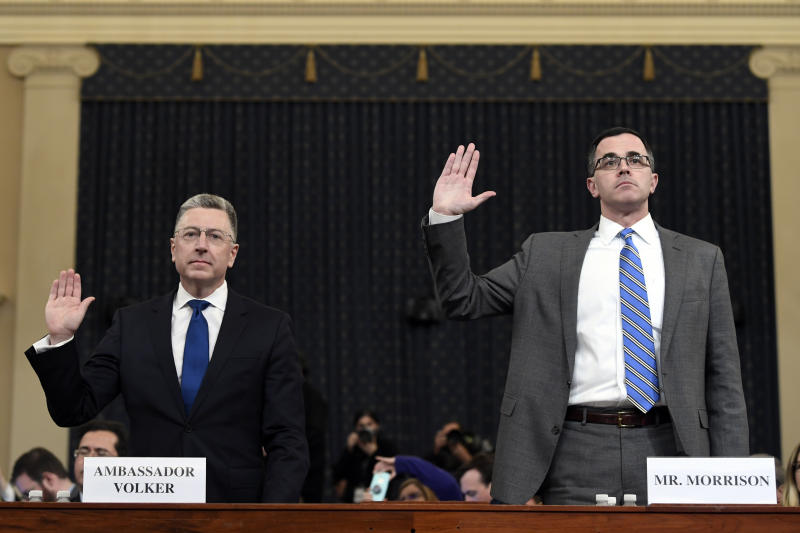 Ambassador Kurt Volker, left, former special envoy to Ukraine, and Tim Morrison, a former official at the National Security Council are sworn in to testify before the House Intelligence Committee on Capitol Hill in Washington, Tuesday, Nov. 19, 2019, during a public impeachment hearing of President Donald Trump's efforts to tie U.S. aid for Ukraine to investigations of his political opponents.(AP Photo/Susan Walsh)