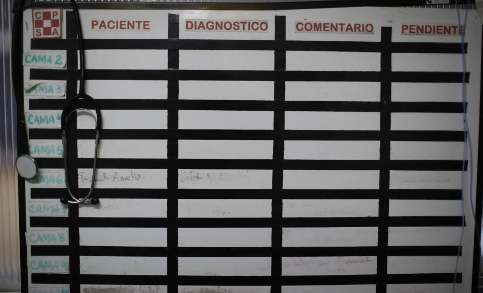 An empty white board hangs inside the ICU at the San Andres Clinic which has been occupied by its former workers since it closed at the start of the year following the death of the hospital's director and owner in Caseros, Argentina, Friday, April 30, 2021. While the pandemic has swelled the need for hospital beds, many private clinics say they're struggling to survive, citing the pandemic having pushed away many non-COVID patients and losing money on coronavirus sufferers because the government insurance program doesn't pay enough to meet costs. (AP Photo/Natacha Pisarenko)