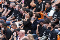 Fans cheers the Miami Heat during the first half of Game 3 of the team's NBA basketball first-round playoff series against the Milwaukee Bucks, Thursday, May 27, 2021, in Miami. (AP Photo/Marta Lavandier)