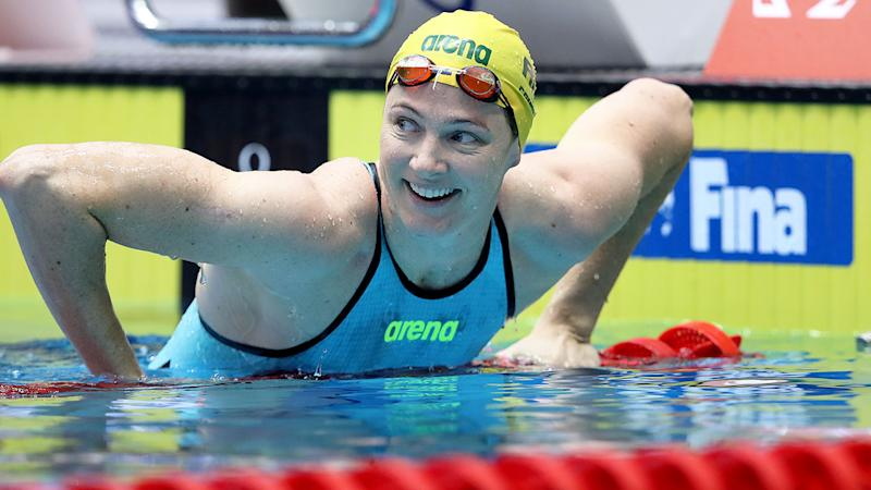 Pictured here, Aussie swimming champion Cate Campbell smiles at the end of a race.