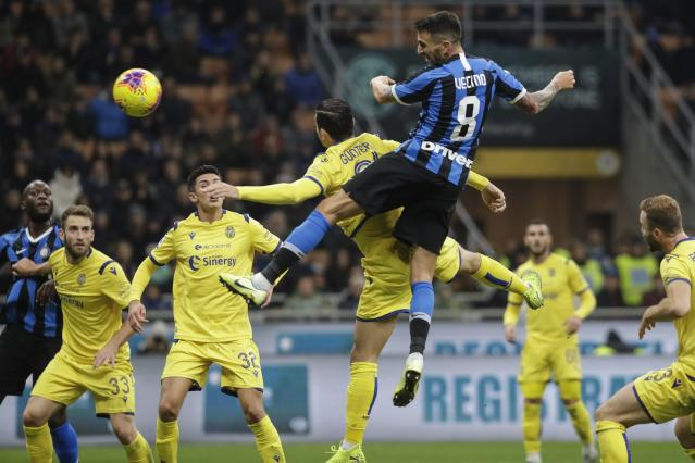 Inter Milan's Matias Vecino scores on a header his side's opening goal during the Serie A soccer match between Inter Milan and Hellas Verona, at the San Siro stadium in Milan, Italy, Saturday, Nov. 9, 2019. (AP Photo/Luca Bruno)