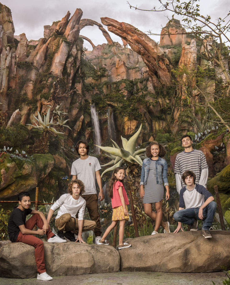 The next-generation <i>Avatar</i> cast: (L-R) Duane Evans Jr (Rotxo of the Metkayina Clan), Britain Dalton (Lo'ak of the Sully Family), Filip Geljo (Aonung of the Metkayina Clan), Trinity Bliss (Tuktirey of the Sully Family), Bailey Bass (Tsireya of the Metkayina Clan), Jack Champion (Javier 'Spider' Socorro), and Jamie Flatters (Neteyam of the Sully Family, standing). (Photo Credit: Sheryl Nields/20th Century Fox)