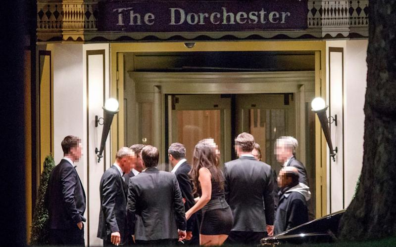 Guests outside The Dorchester Ballroom entrance during the annual Presidents Club Charity Dinner in London on January 18, 2018 - Tolga Akmen