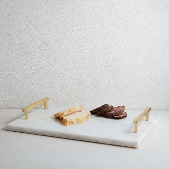 <p>Make a statement with this gorgeous <span>West Elm Marble &amp; Brass Cheese Board</span> ($50).</p>