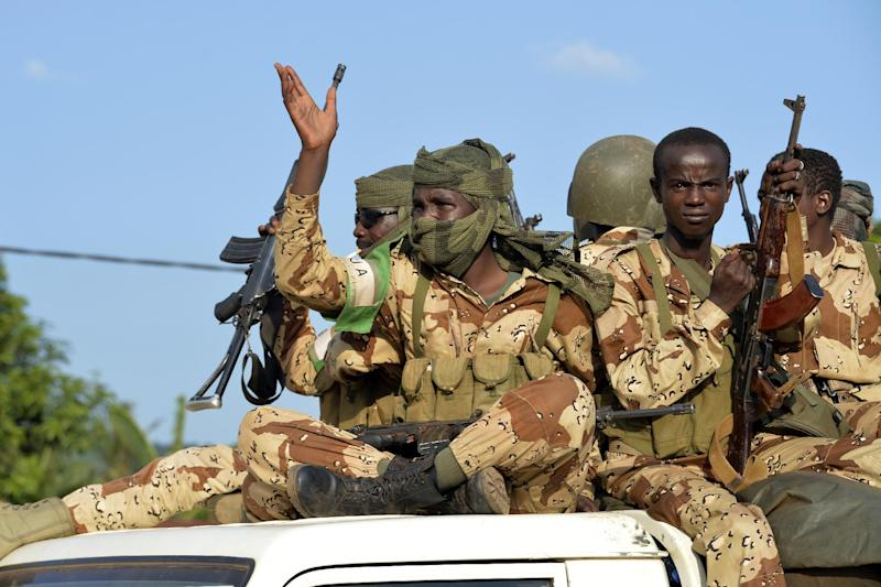 File image shows Chadian soldiers on a pickup truck in the capital of the Central African Republic Bangui on April 4, 2014 (AFP Photo/Miguel Medina)