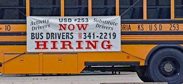 PHOTO: A hiring sign is posted on the side of school bus in Emporia, Kansas, May 5, 2021. (Mark Reinstein/ZUMA)